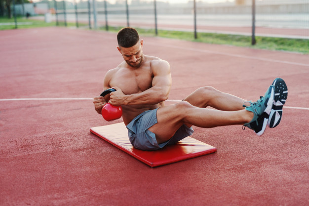 Russian twists to build the stomach muscles